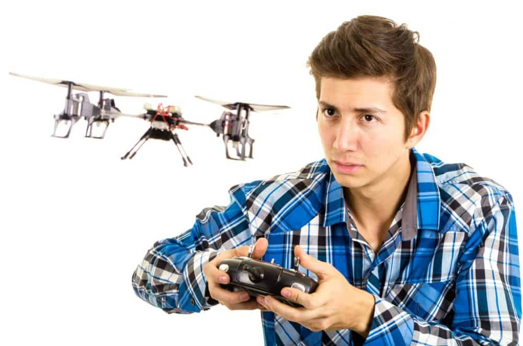 Man playing with a quadcopter drone