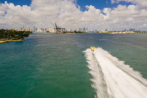 Aerial drone chasing photo miami beach thriller tourism boat