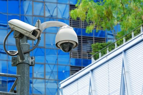 CCTV camera or surveillance operating on office corridor
