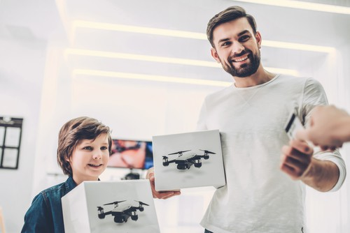 Dad and son in quadcopter store