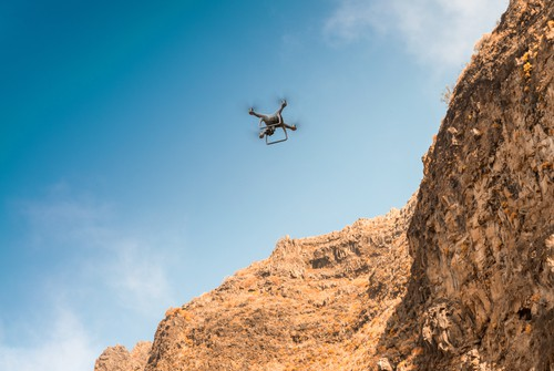 Drone flying through the mountains