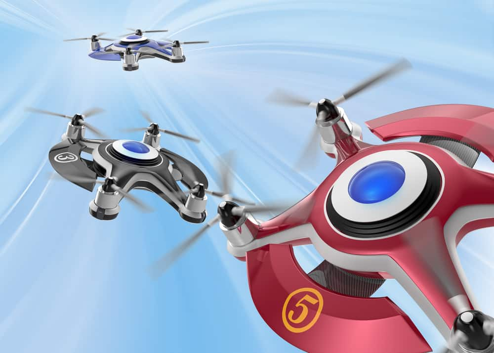 Red racing drones chasing in the sky