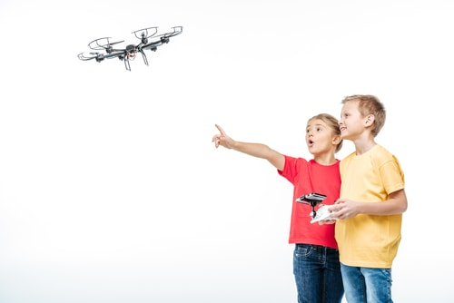 Children playing with hexacopter drone