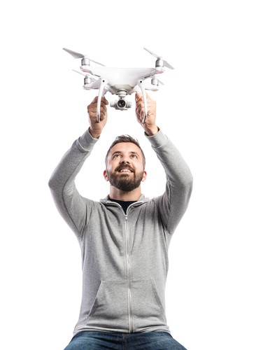 Man holding drone with camera