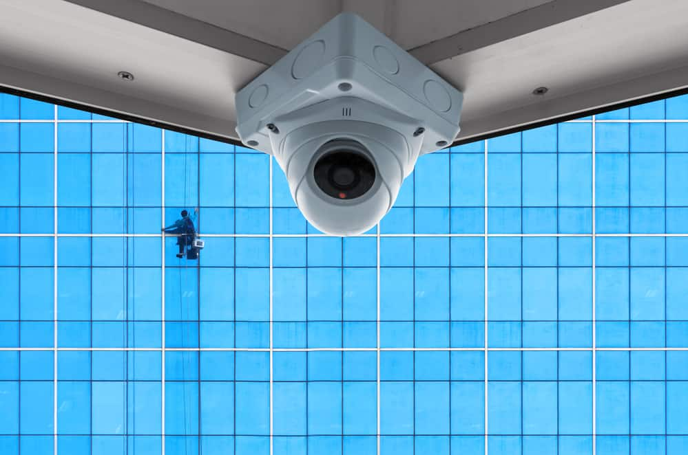 The security cameras on a balcony high building. Cleaning exterior glass
