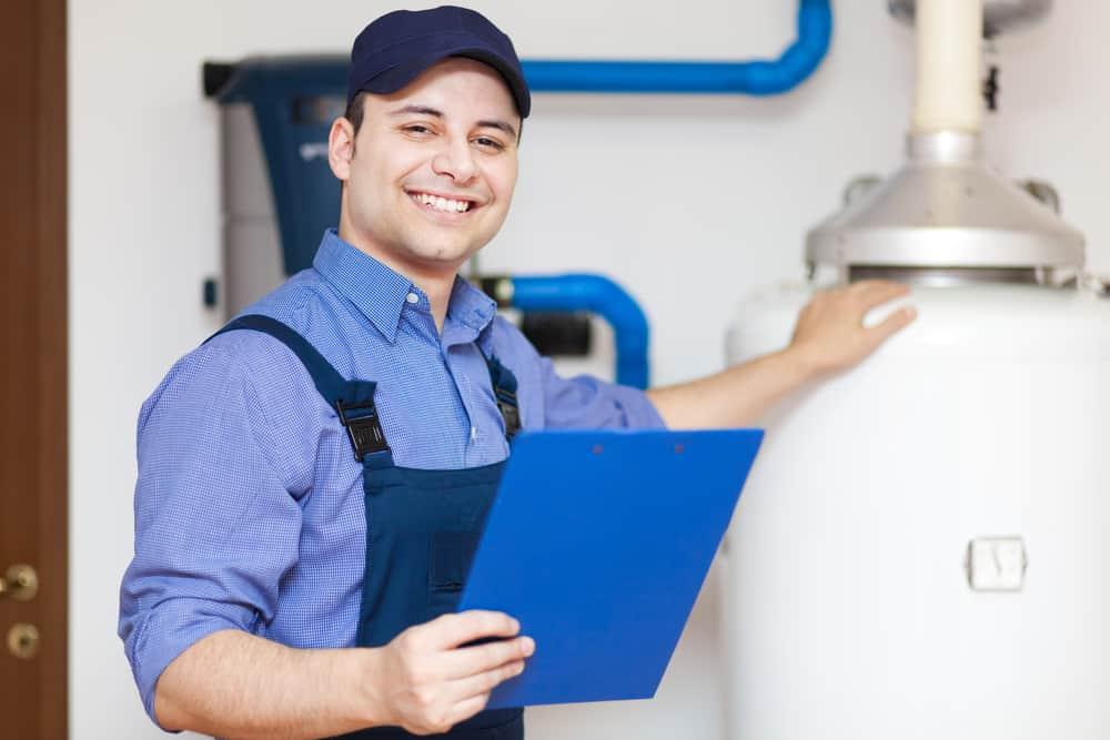 Smiling technician servicing an hot-water heater
