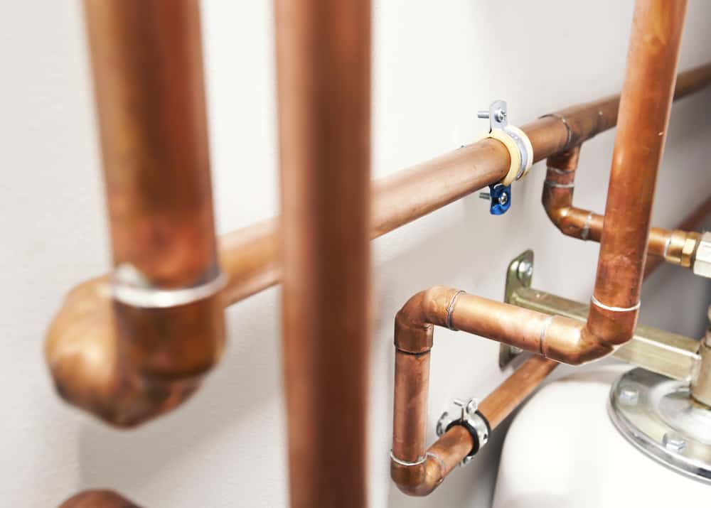 A lot of copper pipes in the boiler-room