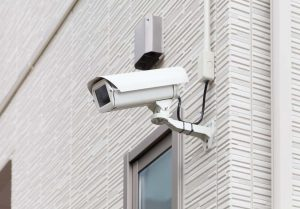 Video camera security system on the wall of the building