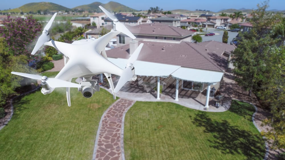 Unmanned Aircraft System (UAV) Quadcopter Drone In The Air Over