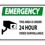 A Sticker about an Emergency this Area Is Under 24 hour Video Surveillance