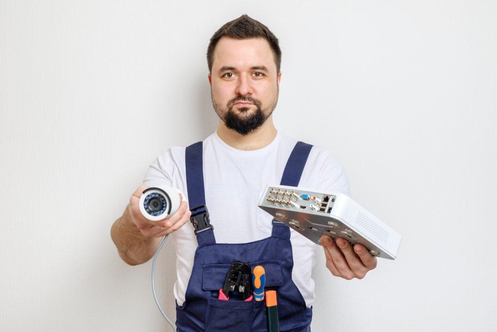 Technician Showing Cctv Security Camera
