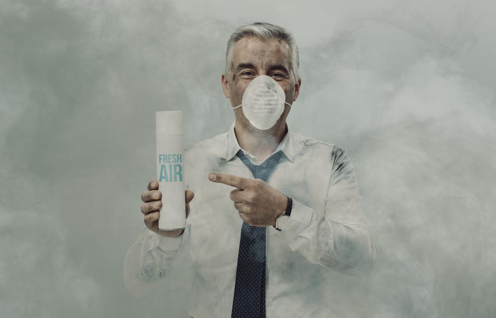 Businessman advertising spray air purifier