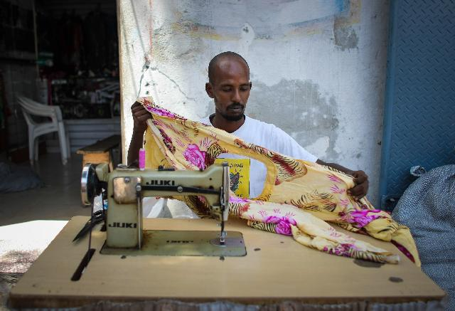 A Man Sewing