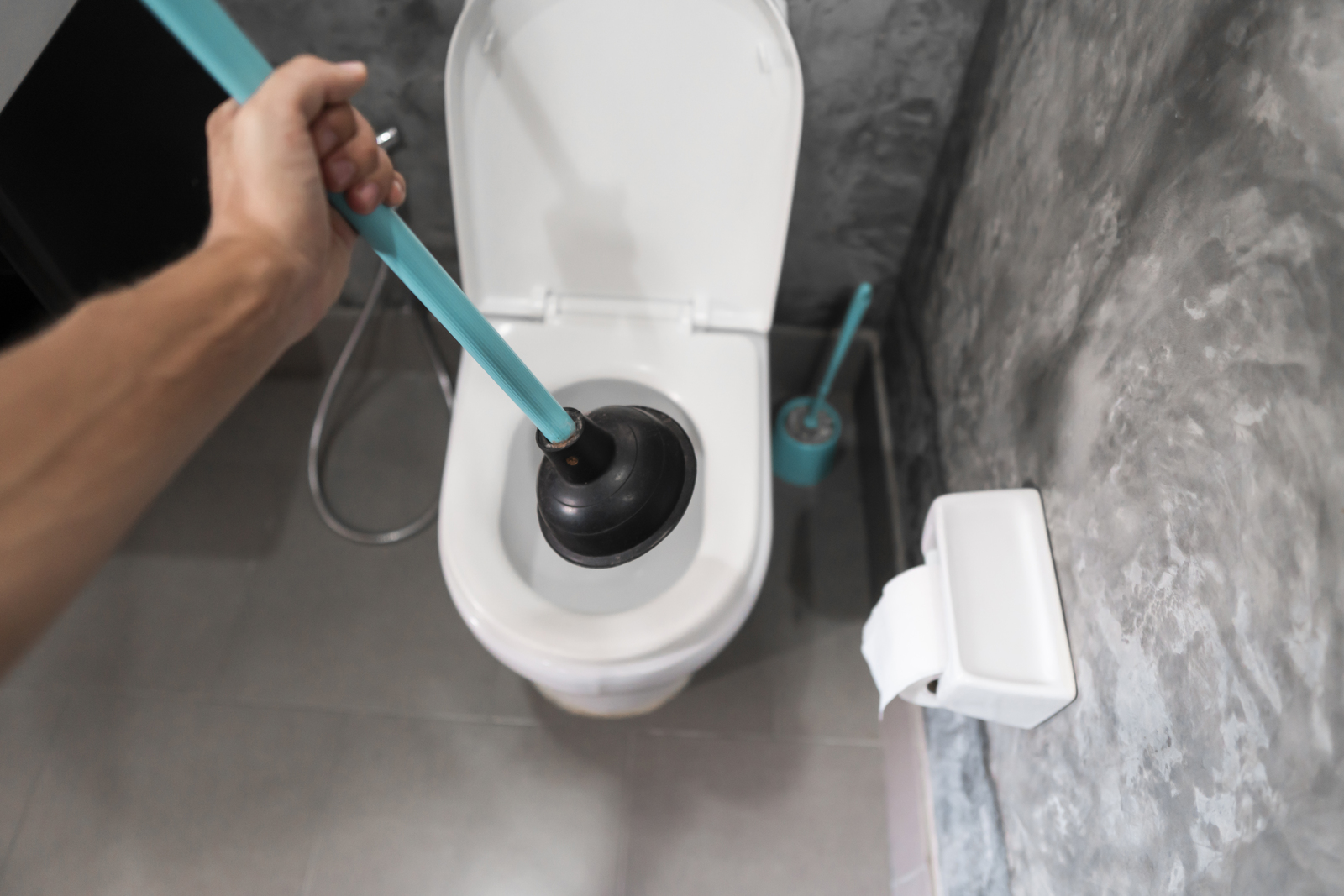 Toilet repair by hand with a Toilet Plunger